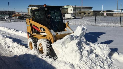 Skid loader snow removal